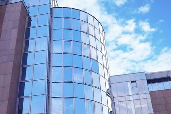 Picture of large round section of commercial building with window film
